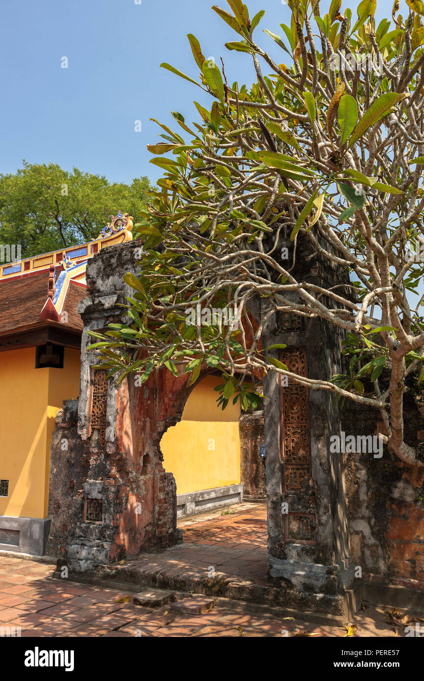 War-damaged archway, approach to Cung Diên Thọ, Imperial City, Hue, Viet Nam Stock Photo