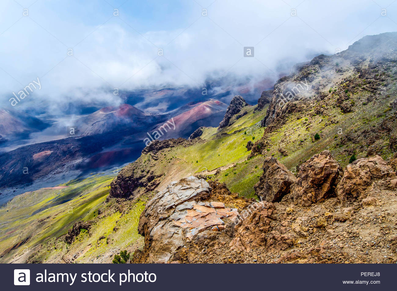 Low Clouds Hang Over Just Below the Crater Rim of Haleakala Volcano on the Island of Maui in Hawaii - Stock Image
