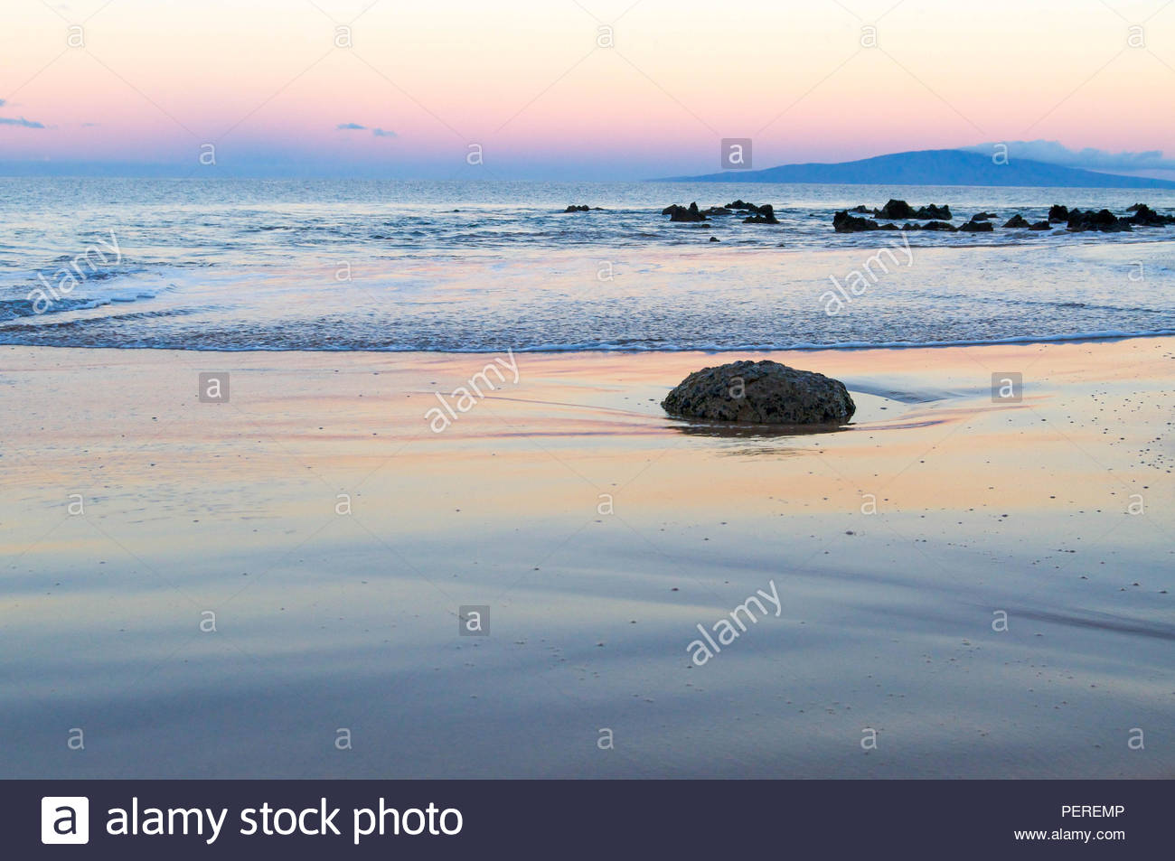 Calm Waters on a Maui Beach at Sunset - Stock Image