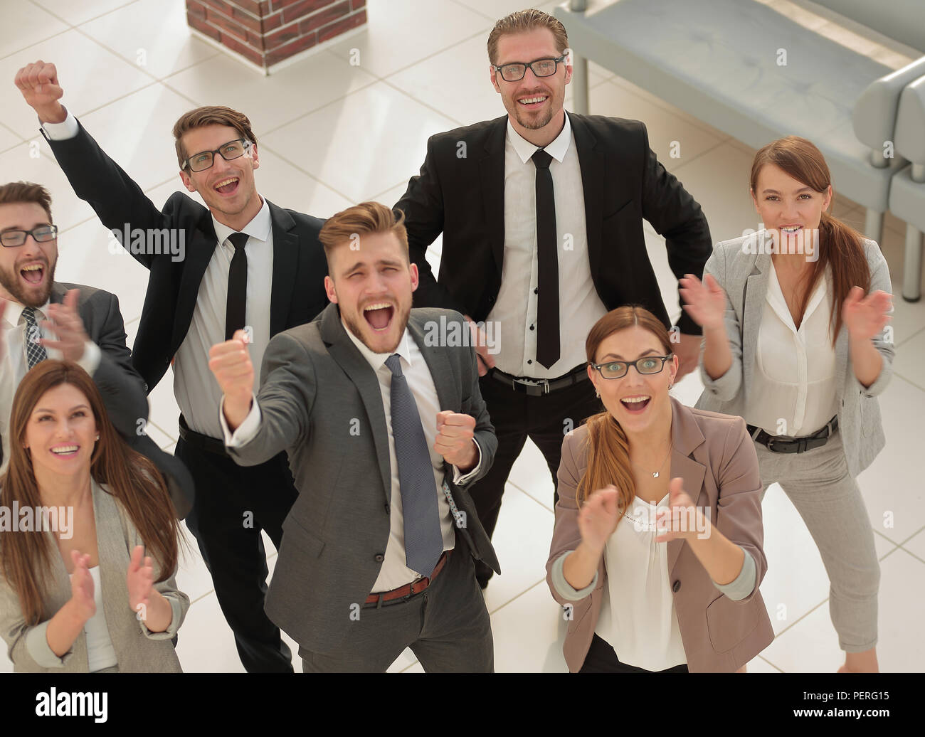 top view.happy business team standing together and looking at the camera - Stock Image