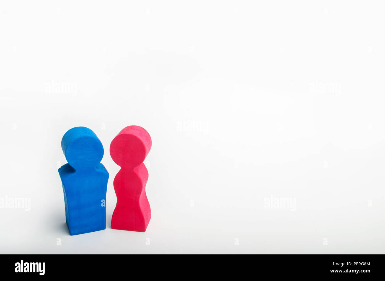 wooden figures of a man and a woman are next to each other. family. gender relations. couple of lovers. marriage, acquaintance. minimalist style. isol - Stock Image