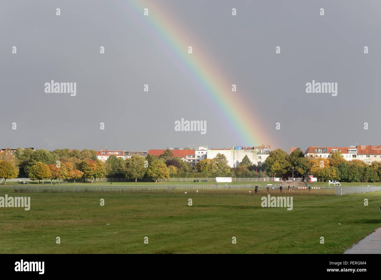 Rainbow over the Tempelhofer field, Berlin. - Stock Image