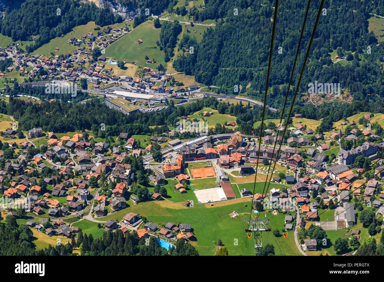 Aerial view of Wengen village centre, Lauterbrunnen and the Lauterbrunnen Valley from the Maennlichen cablecar, Jungfrau region, Switzerland - Stock Image
