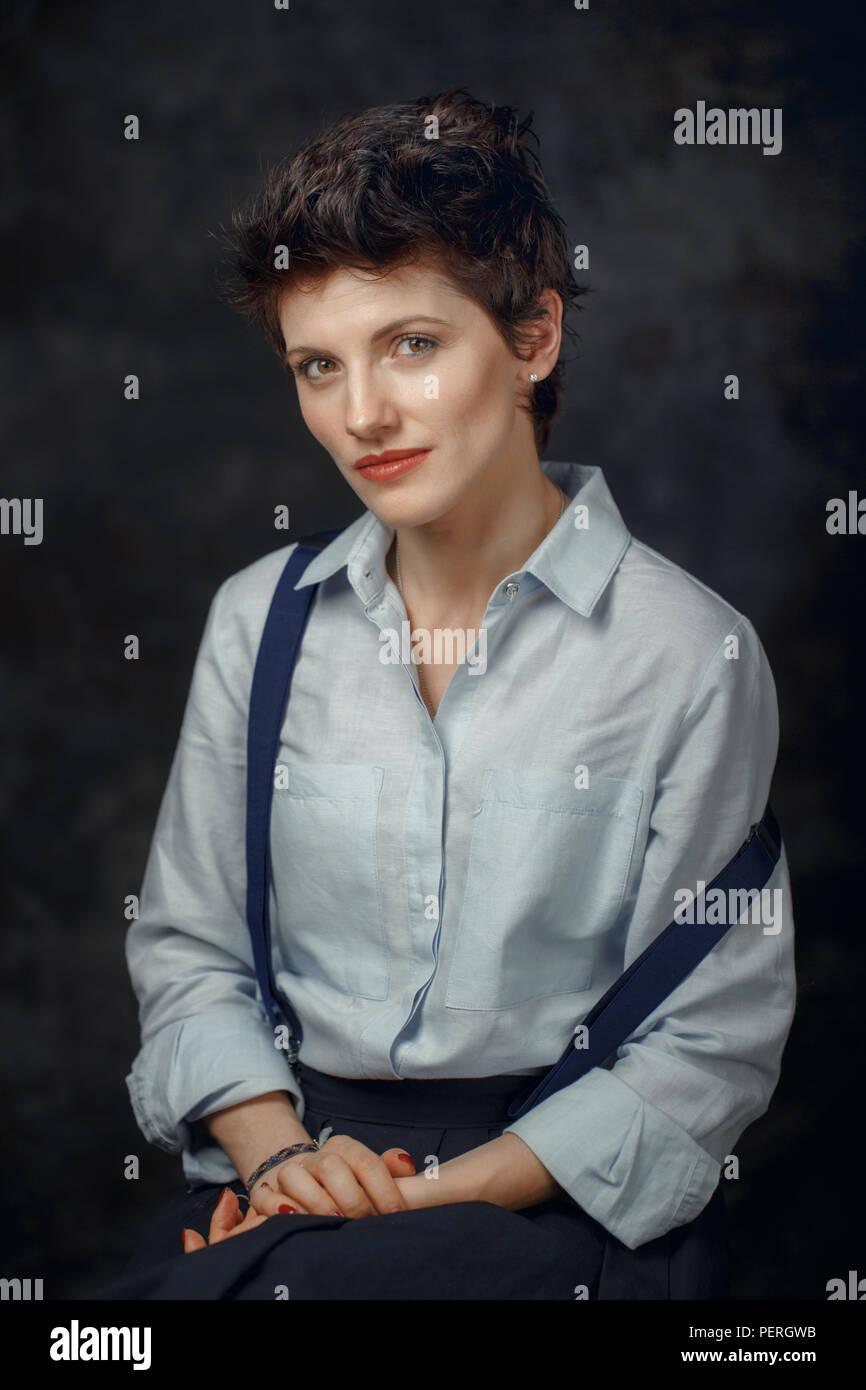 Studio portrait of beautiful pensive middle age brunette Caucasian