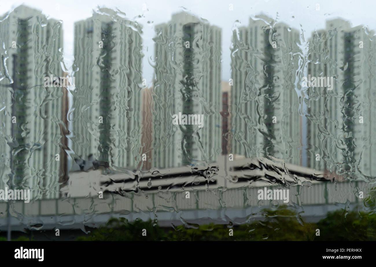 HONG KONG<HONG KONG SAR,CHINA: High-rise apartments in Hong Kong seen through rain on the window. - Stock Image