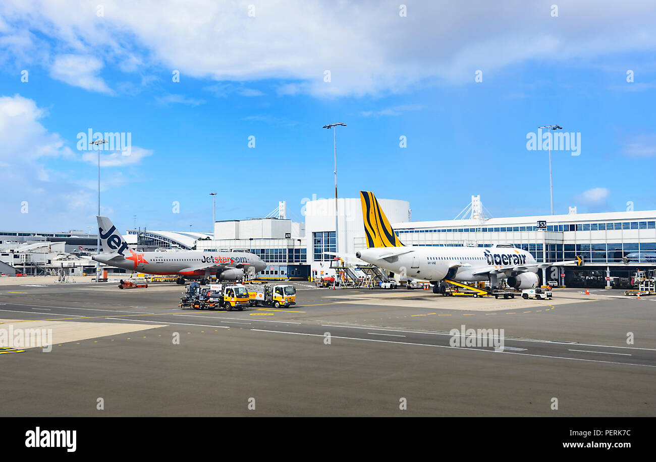 Jetstar and Tigerair airliners at the gate on the tarmac, Sydney Airport, Domestic Terminal, New South Wales, NSW, Australia Stock Photo