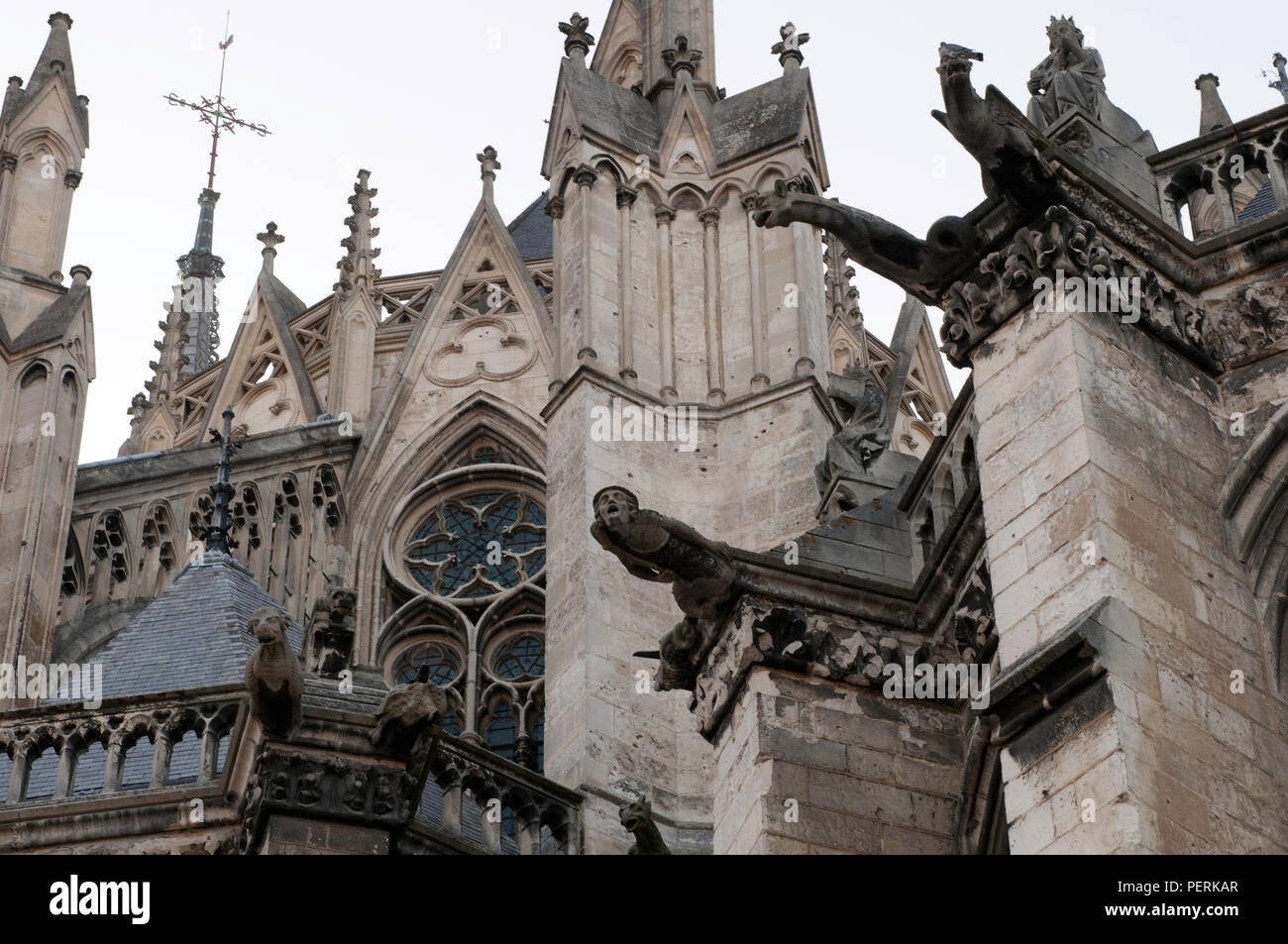 Frightening gargoyles extend from the Amiens Cathedral, Notre-Dame dAmiens, in Amiens, France. Amiens is worth a visit when traveling Northern France. - Stock Image