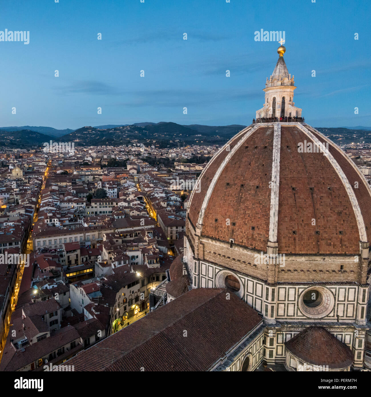 Florence, Italy - March 23, 2018: Tourists gather on the cupola of Florence's Duomo cathedral to watch the sunset. Stock Photo