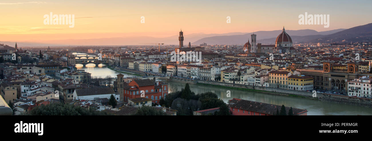 Florence, Italy - March 22, 2018: Afternoon sun illuminates the cityscape of Florence, including the landmark Duomo Cathedral and Ponte Vecchio bridge - Stock Image