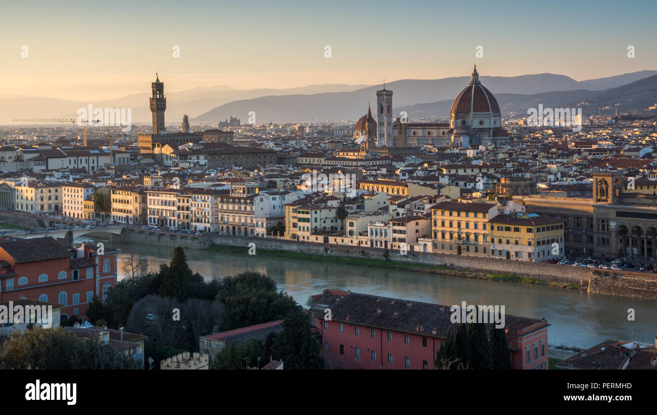 Florence, Italy - March 22, 2018: Landmarks including the Duomo cathedral and Palazzo Vecchio stand in the Renaissance cityscape of Florence, with the Stock Photo