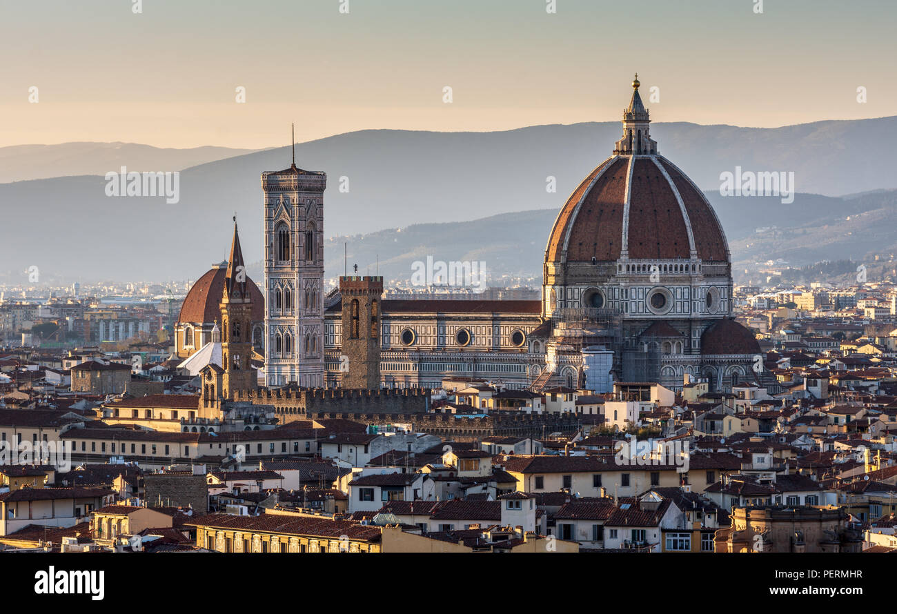 Florence, Italy - March 22, 2018: Landmarks including the Duomo cathedral stand in the Renaissance cityscape of Florence, with the hills of Monteferra Stock Photo