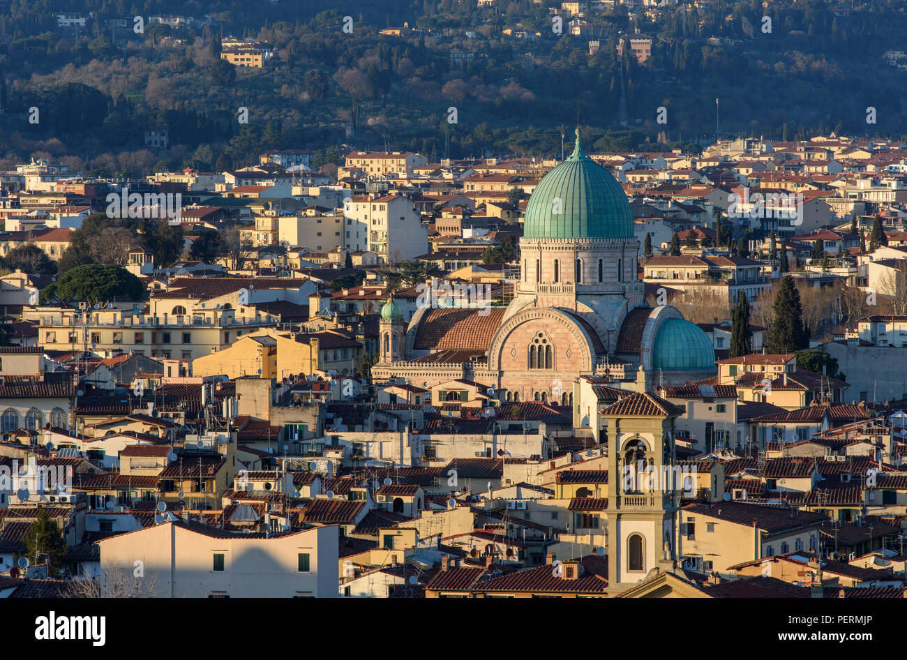 Florence, Italy - March 22, 2018: The Synagogue of Florence rises from streets of traditional houses in the city. - Stock Image