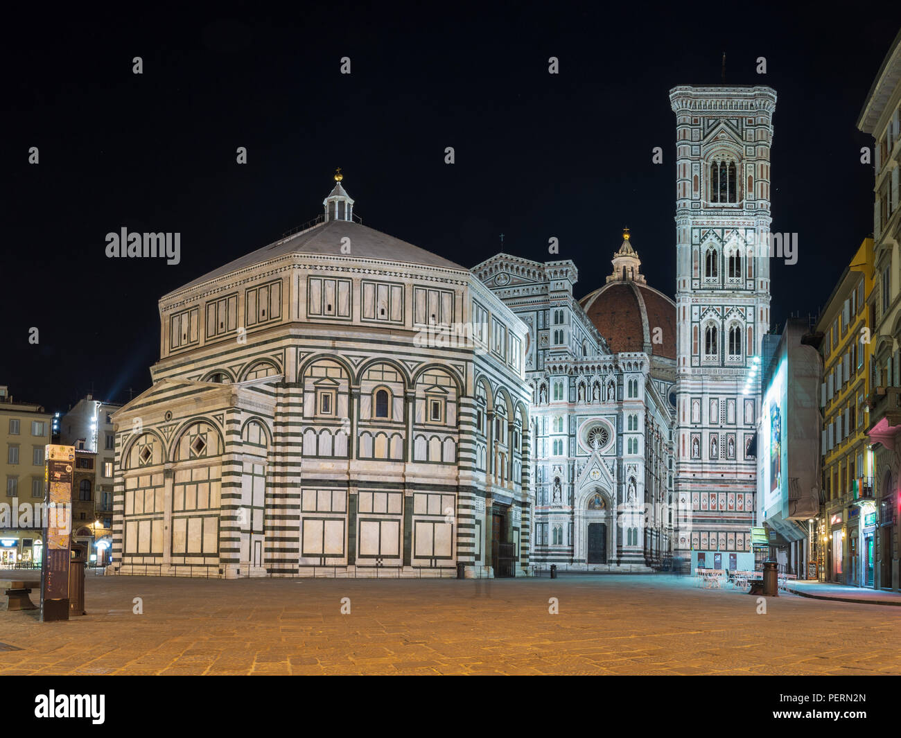 Florence, Italy - March 21, 2018: The Renaissance cathedral, bell tower and baptistry of Florence are lit up at night. - Stock Image