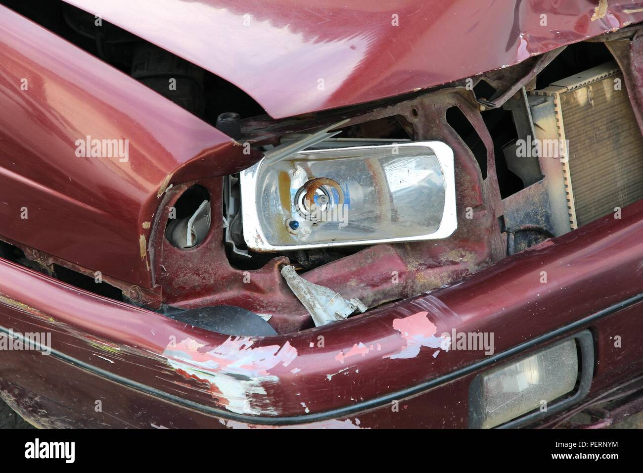 Small generic car with dented front wing. Vehicle accident result. - Stock Image
