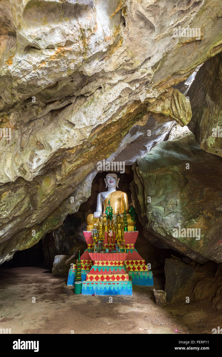 Several Buddha statues on altar inside the Tham Hoi Cave near Vang Vieng, Vientiane Province, Laos. - Stock Image