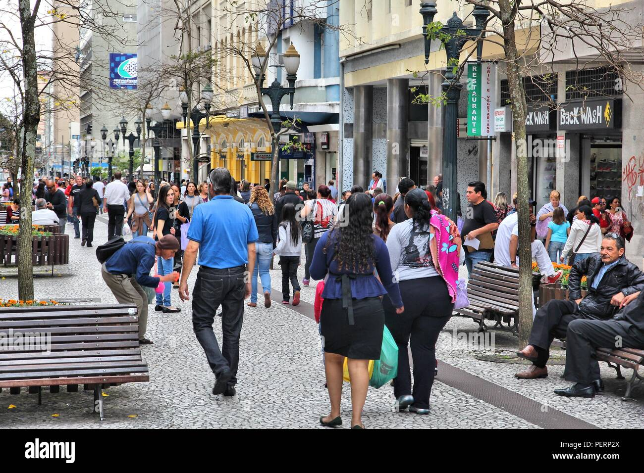 CURITIBA, BRAZIL - OCTOBER 7, 2014: People shop in pedestrian zone of Curitiba, Brazil. Curitiba is the 8th most populous city of Brazil with 1.76 mil - Stock Image