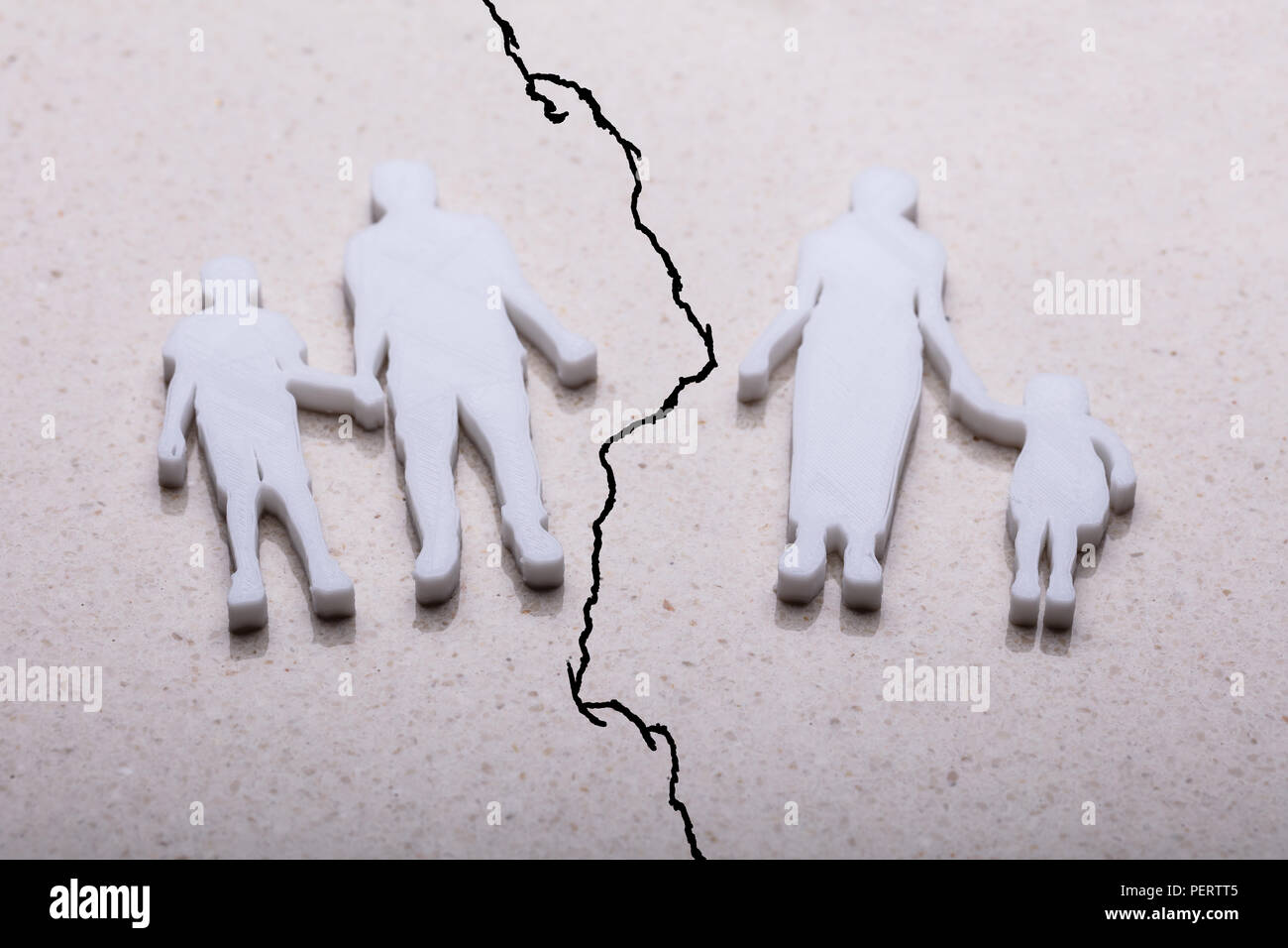 Separation Of Family Figures On Marble Background - Stock Image
