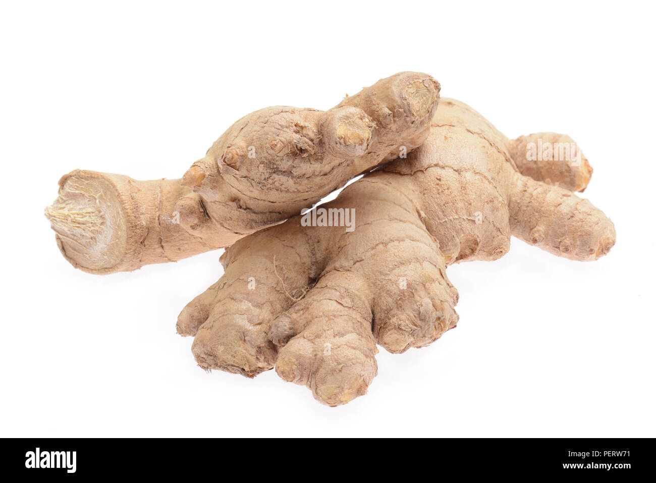 Ginger roots isolated on a white background. - Stock Image