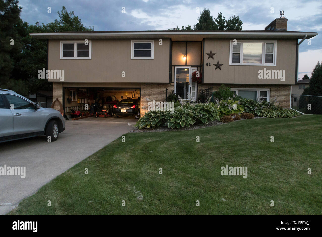 Residential House Exterior in Middle Class Neighborhood, MT, USA Stock Photo