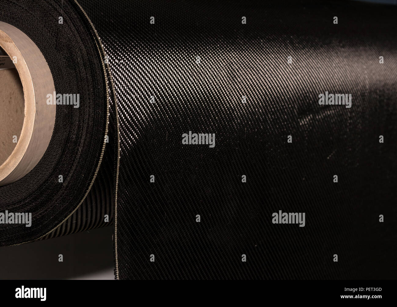 Carbon fiber rolled weave composite material industry - Stock Image