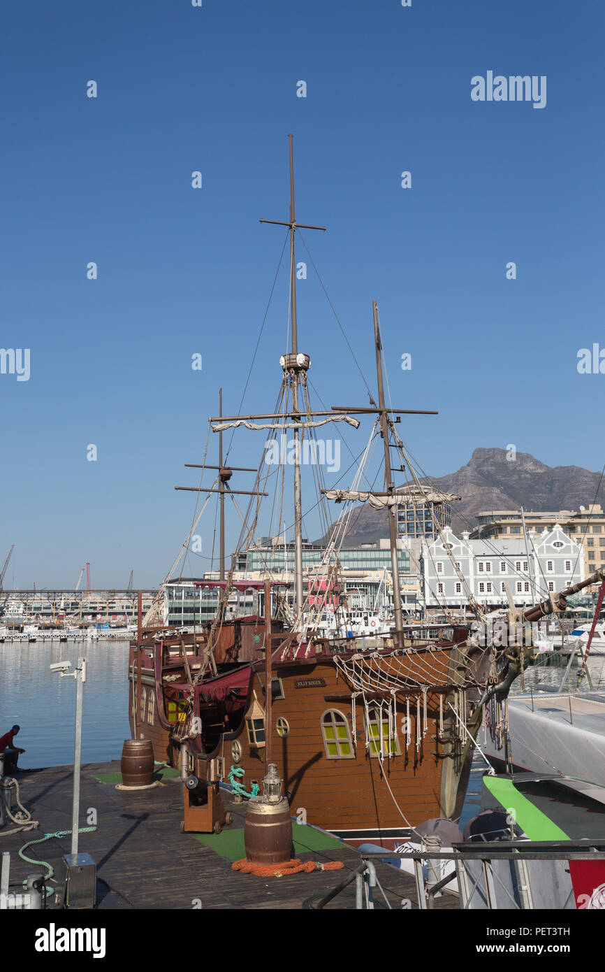 the jolly roger pirate boat moored at a jetty at V&A Waterfront, Cape Town, South Africa - Stock Image