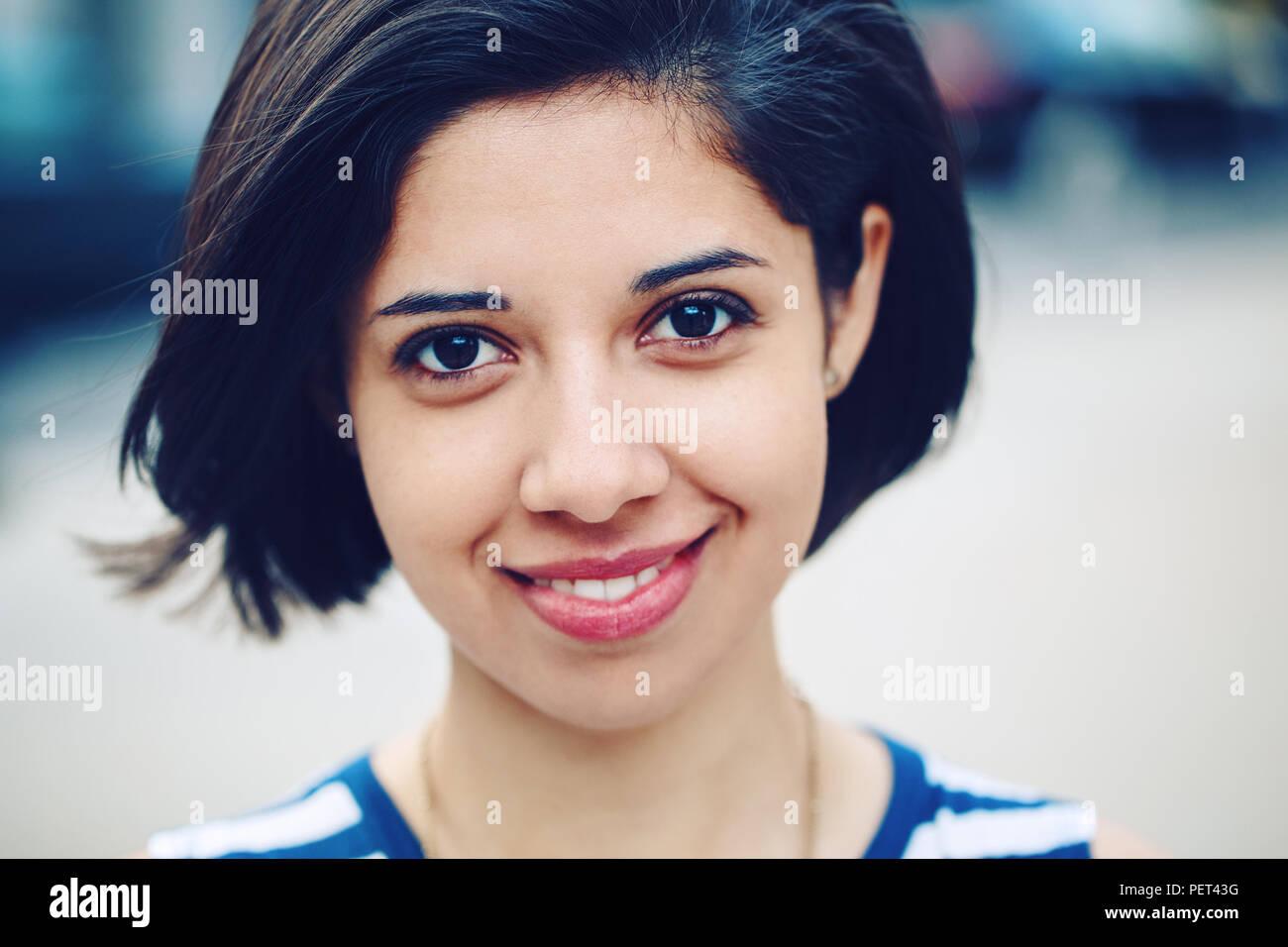 https://c8.alamy.com/comp/PET43G/closeup-portrait-of-beautiful-smiling-young-latin-hispanic-girl-woman-with-short-dark-black-hair-bob-black-eyes-outside-looking-in-camera-toned-wit-PET43G.jpg