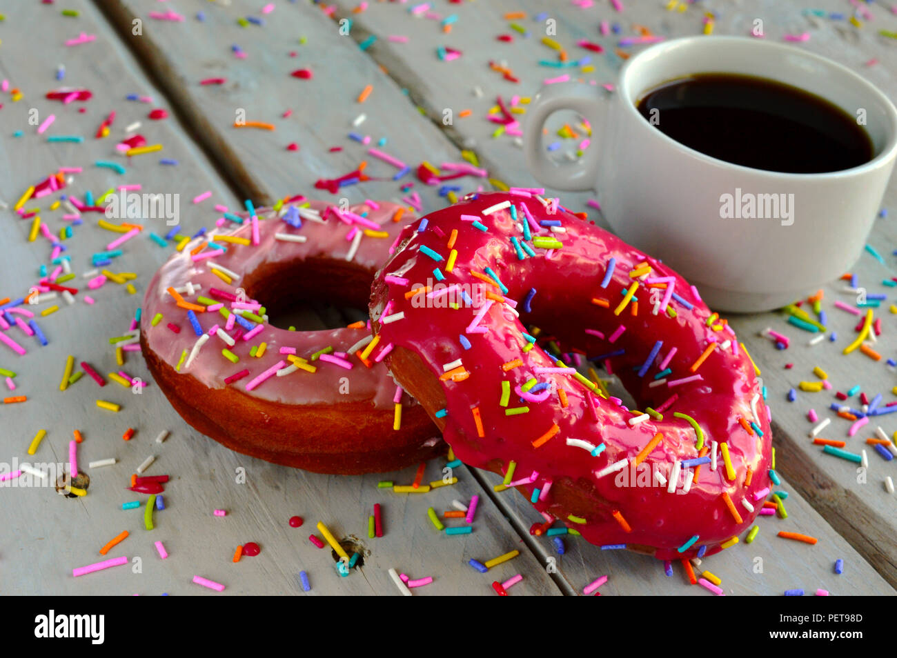Doughnuts with a cup of coffee - Stock Image