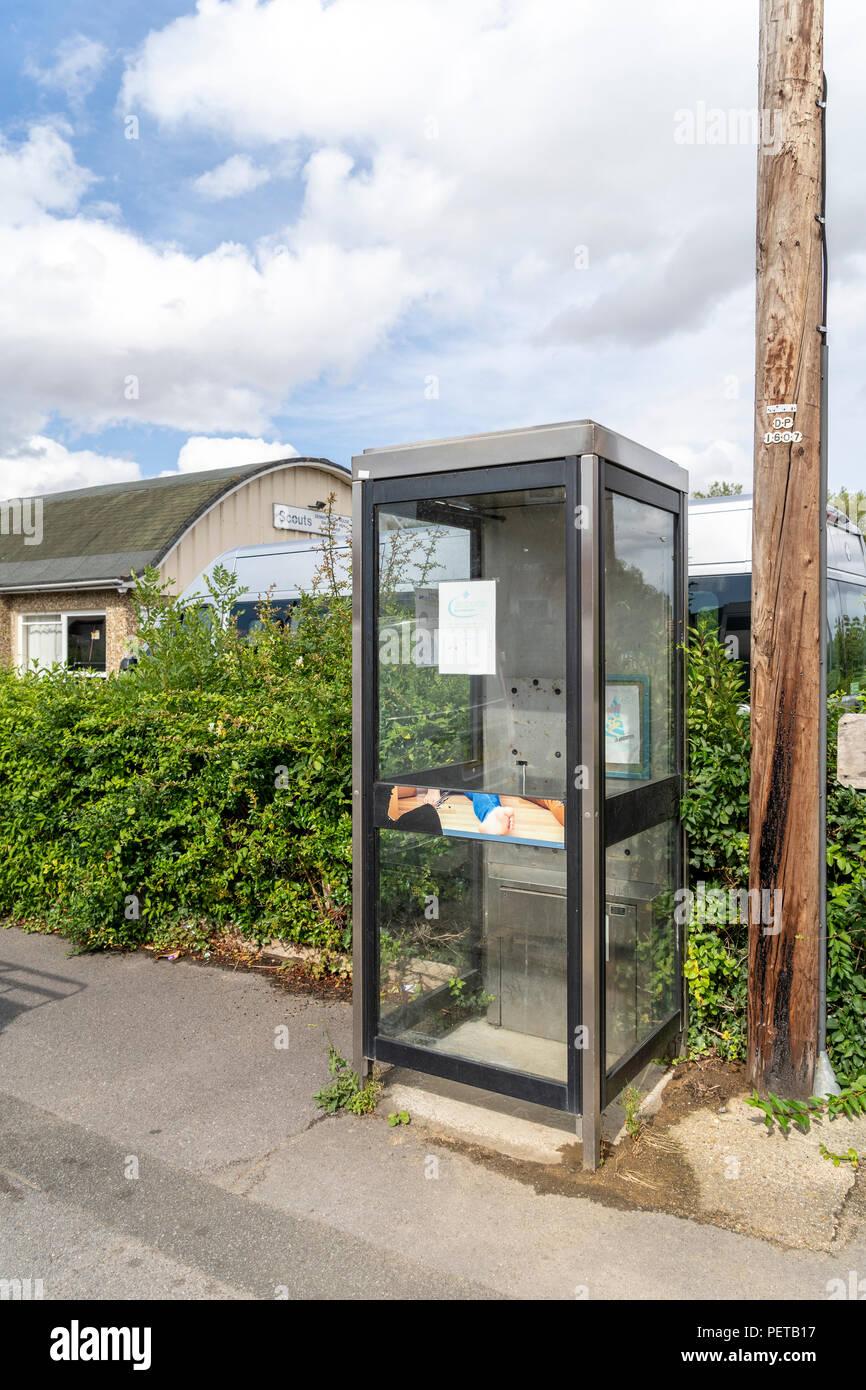 De-commissioned telephone kiosk - Stock Image