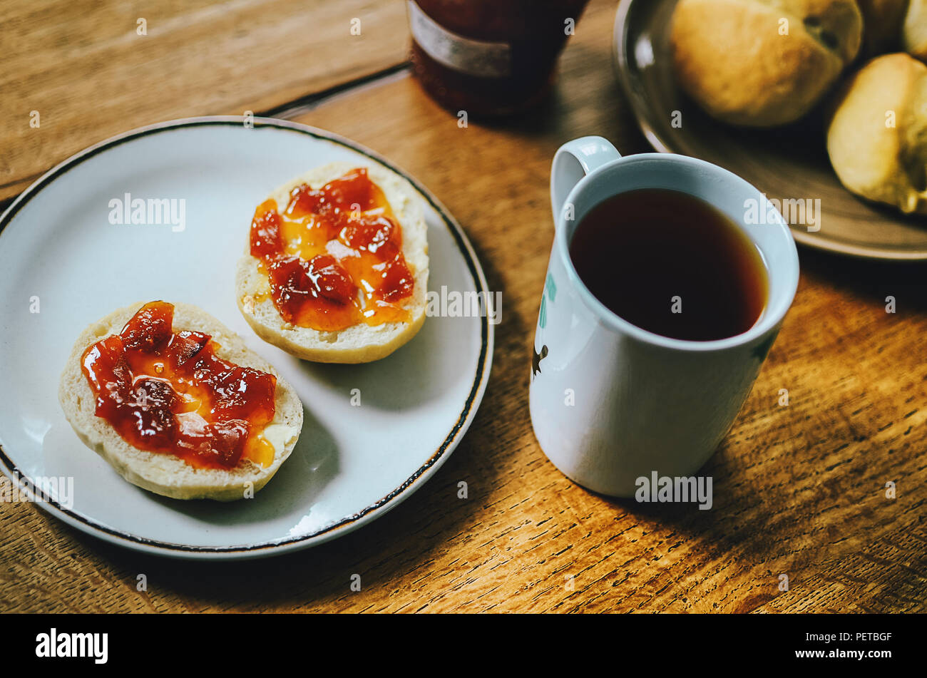 Cup Of Black Tea With Red Jam On Bread Buns For Tasty Breakfast Simple And Delicious Breakfast Idea Wooden Table Background Stock Photo Alamy