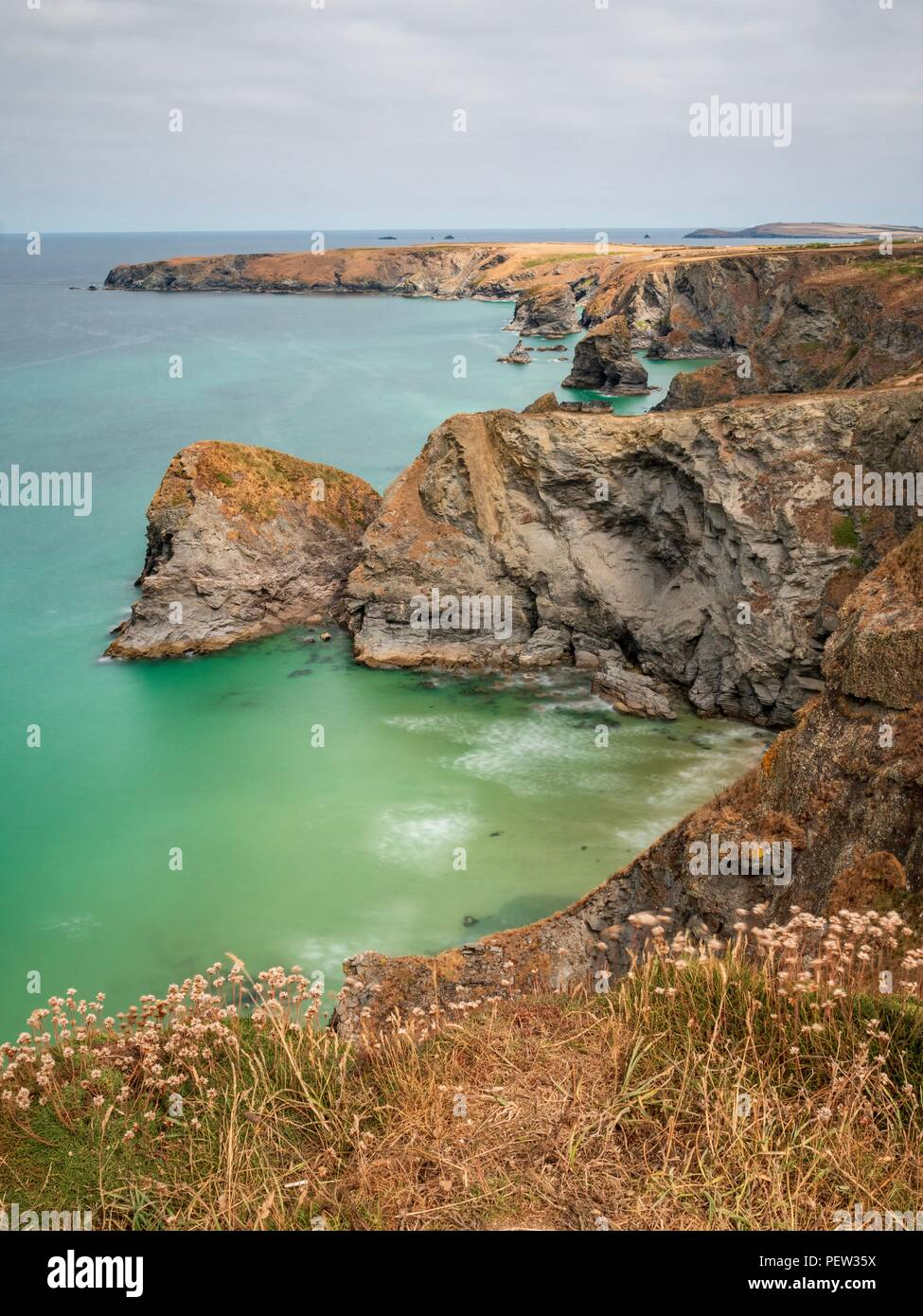 A long exposure looking down onto the North Cornwall coastline at Bedruthan Steps Stock Photo