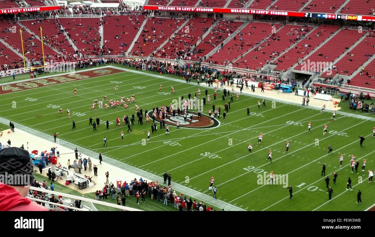 U.S. Army Reserve Sgt. 1st Class Brian Williams and his fiancée, Eileen Clemens, enjoy a game at Levi Stadium, Dec. 20, 2015. Crediting military training and vigilance, Williams reported a man acting suspiciously taking pictures of the stadium (home of Super Bowl 50) with what appeared to be a small camera and some sort of transmission device. Stadium authorities detained the man and confirmed Williams' suspicions, stating the FBI and Homeland Security officials were holding the man for further questioning. (Photo courtesy of Sgt. 1st Class Brian Williams) - Stock Image