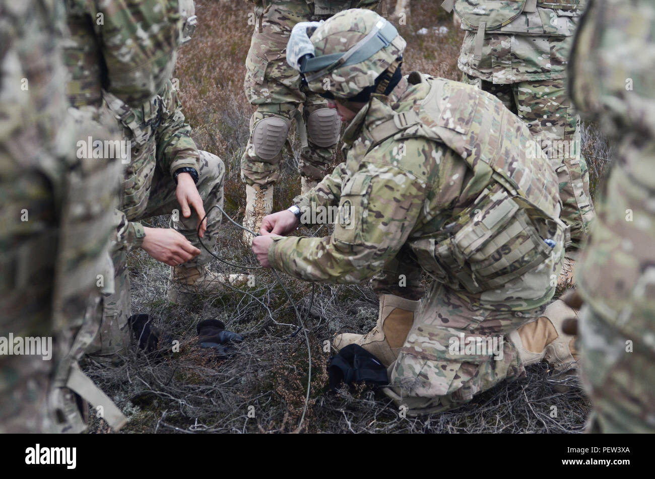 Soldiers of 3rd Squadron, 2nd Cavalry Regiment, stationed out of Vilseck, Germany, prepare the fuse lines for the improvised explosive devices during a demolition exercise at Adazi Training Area in Latvia, Jan. 29, 2016. (Photo by Staff Sgt. Steven Colvin/Released) - Stock Image