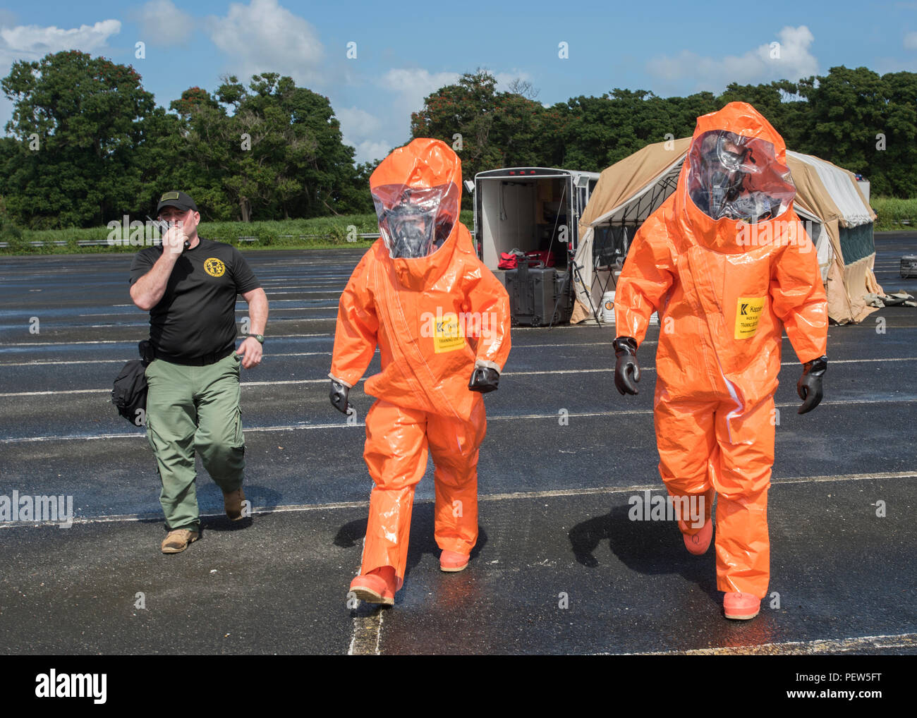 U.S. Staff Sgt. Rusty Greeno, survey team member, and Sgt. Dorian Quarmby, survey team member, 15th Civil Support Team, Vermont National Guard, walk toward the simulated hazardous area for a man-down drill during the unit's training proficiency evaluation at Roberto Clemente Stadium, Carolina, Puerto Rico, Jan. 26, 2016. The 15th CST is conducting the unit's 18-month training proficiency evaluation. (U.S. Army National Guard Photo by Staff Sgt. Nathan Rivard) - Stock Image