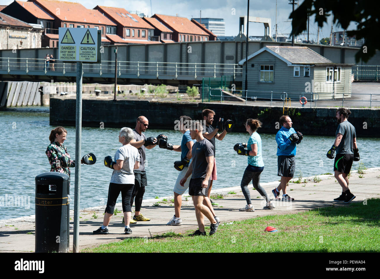 Keep fit exercising on the quayside, Bristol Harbour. UK - Stock Image
