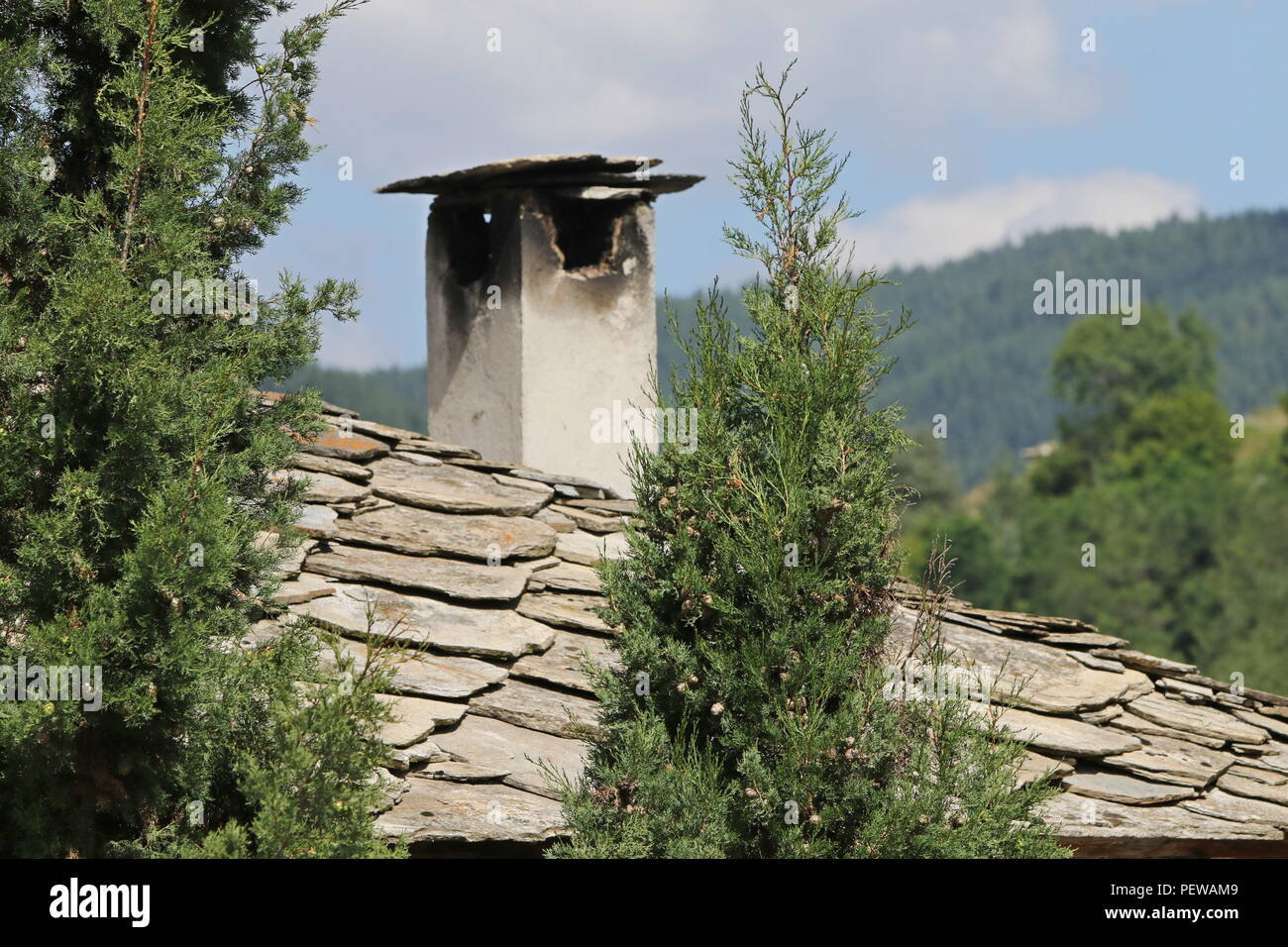 Old chimney on house in Kovachevitsa village Stock Photo