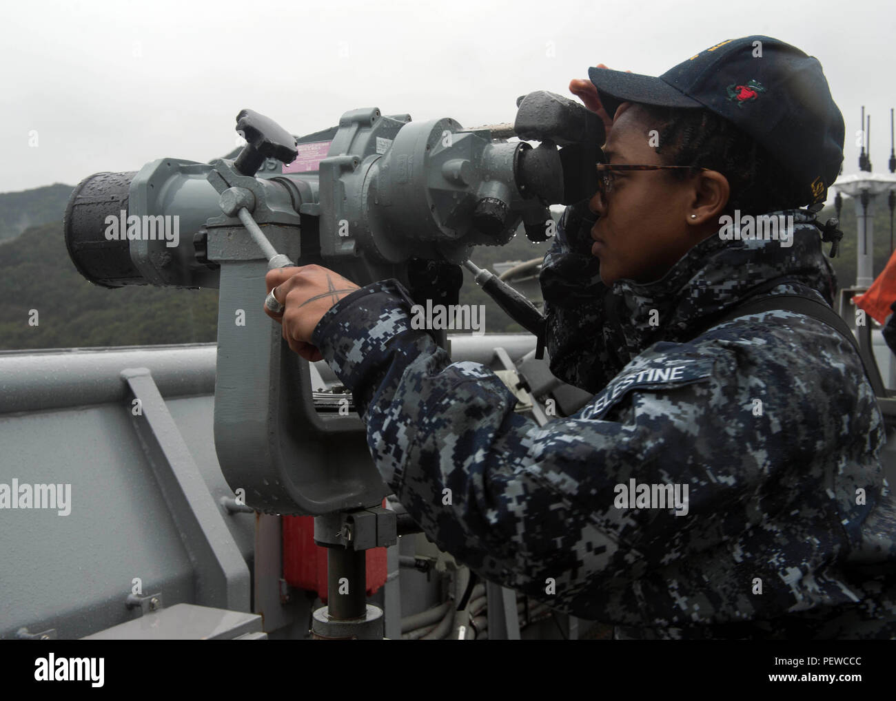 SASEBO BAY, Japan (Jan. 29, 2016) - Operations Specialist 2nd Class Garielle L. Celestine scans the horizon as amphibious dock landing ship USS Germantown (LSD 42) transits the Sasebo Bay. Germantown is assigned to the Bonhomme Richard Amphibious Ready Group (ARG) and is currently underway in the 7th Fleet area of operations. (U.S. Navy photo by Mass Communication Specialist 3rd Class James Vazquez/Released) - Stock Image