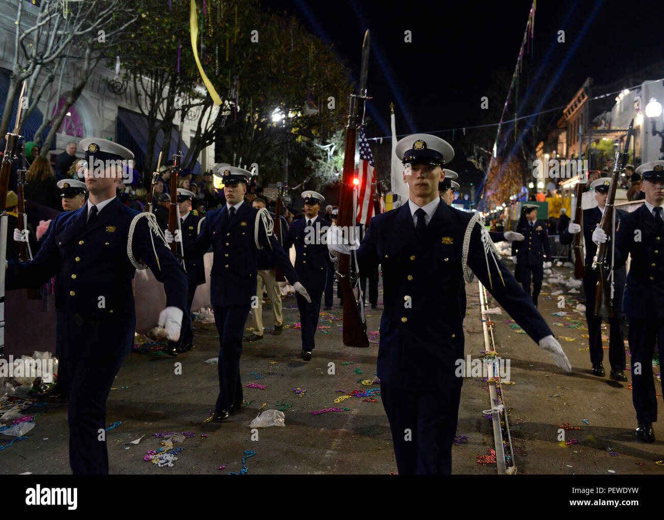 Members of the Coast Guard Ceremonial Honor Guard perform an Order Arms rifle routine while marching down the streets of New Orleans during the 2016 Bacchus Mardi Gras Parade, Feb. 7, 2016. The Coast Guard Ceremonial Honor Guard participates in multiple military events around the country. (U.S. Coast Guard photo by Petty Officer 2nd Class Jonathan Lally) Stock Photo