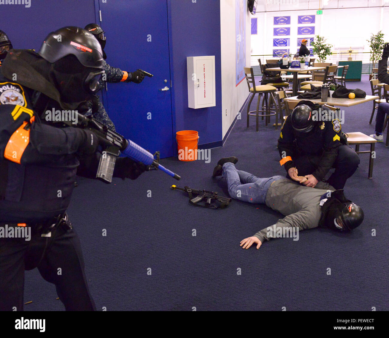 160205-N-ZA795-015 WASHINGTON (Feb. 5, 2016) -- Security forces from Naval Support Facility Annapolis neutralize a simulated 'active shooter' during a drill as part of the annual exercise Solid Curtain-Citadel Shield 2016. Solid Curtain-Citadel Shield is an annual exercise that assesses the readiness of Navy security personnel to respond to threats located on naval installations and individual units. (U.S. Navy photo by Mass Communication Specialist 1st Class Pedro A. Rodriguez/Released) - Stock Image