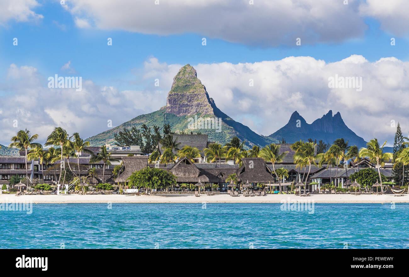 Flic en flac beach with Piton de la Petite Riviere Noire Mauritius. Stock Photo