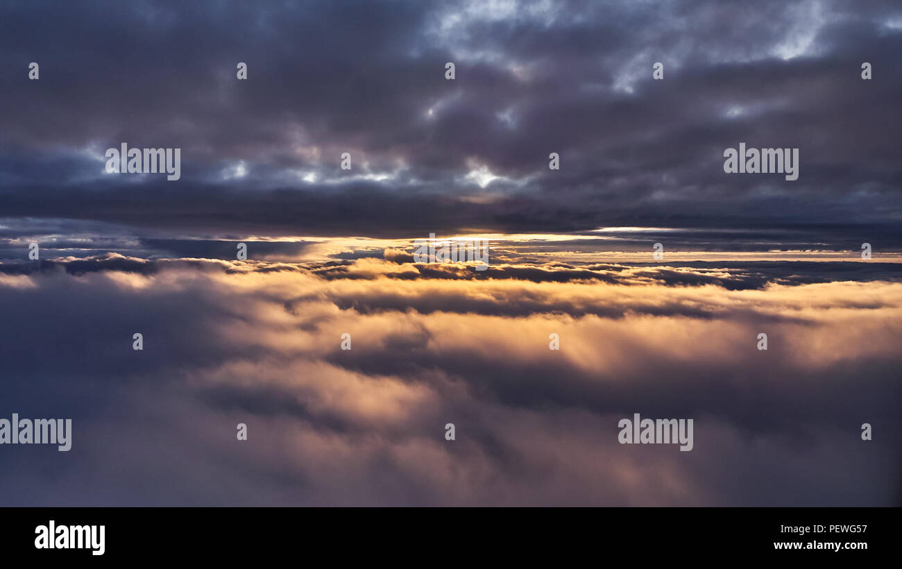 Sun between the clouds - Stock Image
