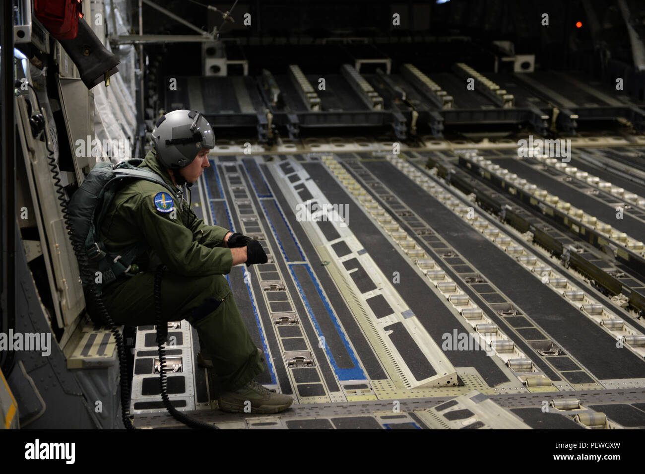 U.S. Air Force Senior Airman Glen Baker, 7th Airlift Squadron, waits for a container delivery systems drop on a C-17 Globemaster III from McChord Air Force Base, Wash., during Large Package Week at Pope Army Airfield, N.C., Feb. 4, 2016. Large Package Week leads up to Joint Operational Access Exercise 16-5, where in Army and Air Force units work together to improve interoperability for worldwide crisis, contingency and humanitarian operations. (U.S. Air Force photo by Staff Sgt. Sandra Welch) - Stock Image