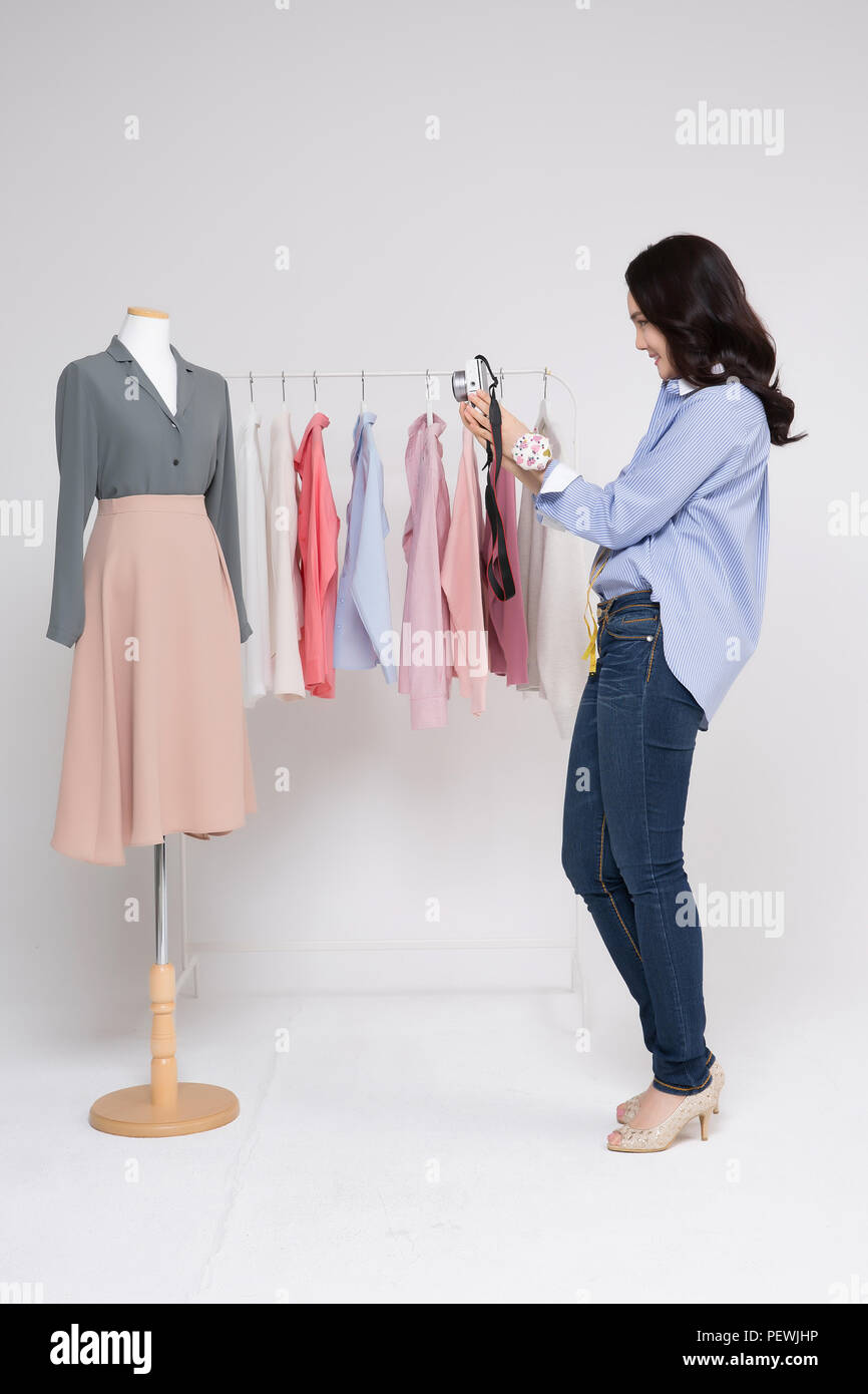 Young Female Fashion Designer Using Digital Tablet And At Work Isolated On White Background 394 Stock Photo Alamy
