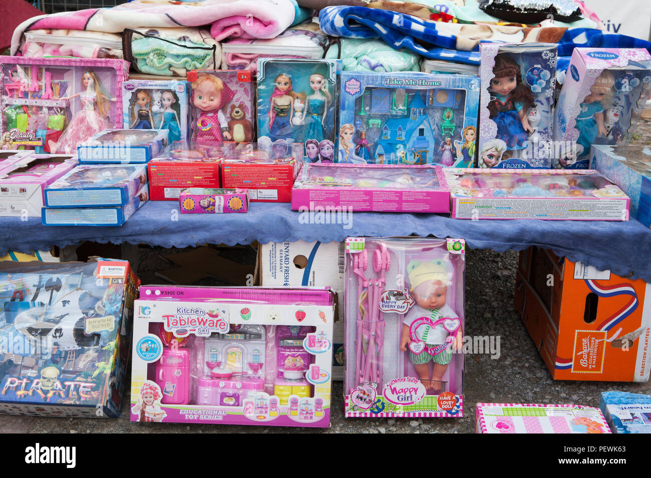 Plastic children's toys at a market stand, Germany, Europe - Stock Image