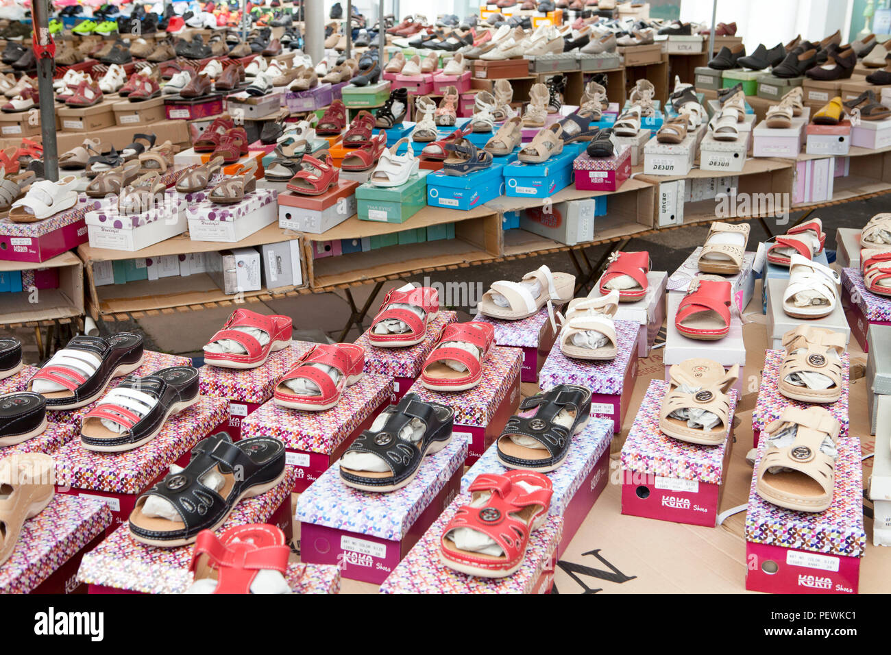 Market stand selling shoes, Germany, Europe - Stock Image