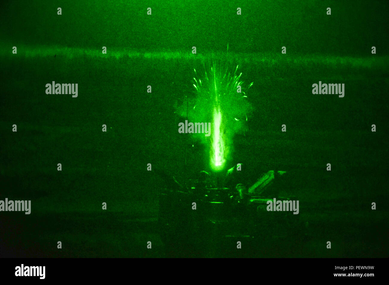 Soldiers of 3rd Squadaron, 2nd Cavalry Regiment, stationed out of Vilseck, Germany, fire a 120mm illumination round out of an M1129 Mortar Carrier Vehicle during a night training exercise at Adazi Training Area in Latvia, Feb. 3, 2016. (Photo by U.S. Army Staff Sgt. Steven M. Colvin/Released) - Stock Image