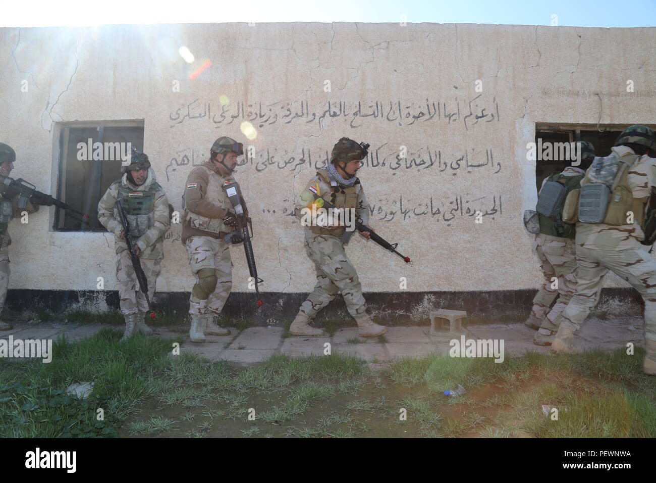 8a9e3104ac4 Iraqi soldiers with the 71st Iraqi Army Brigade advance towards a building  during a building clearance