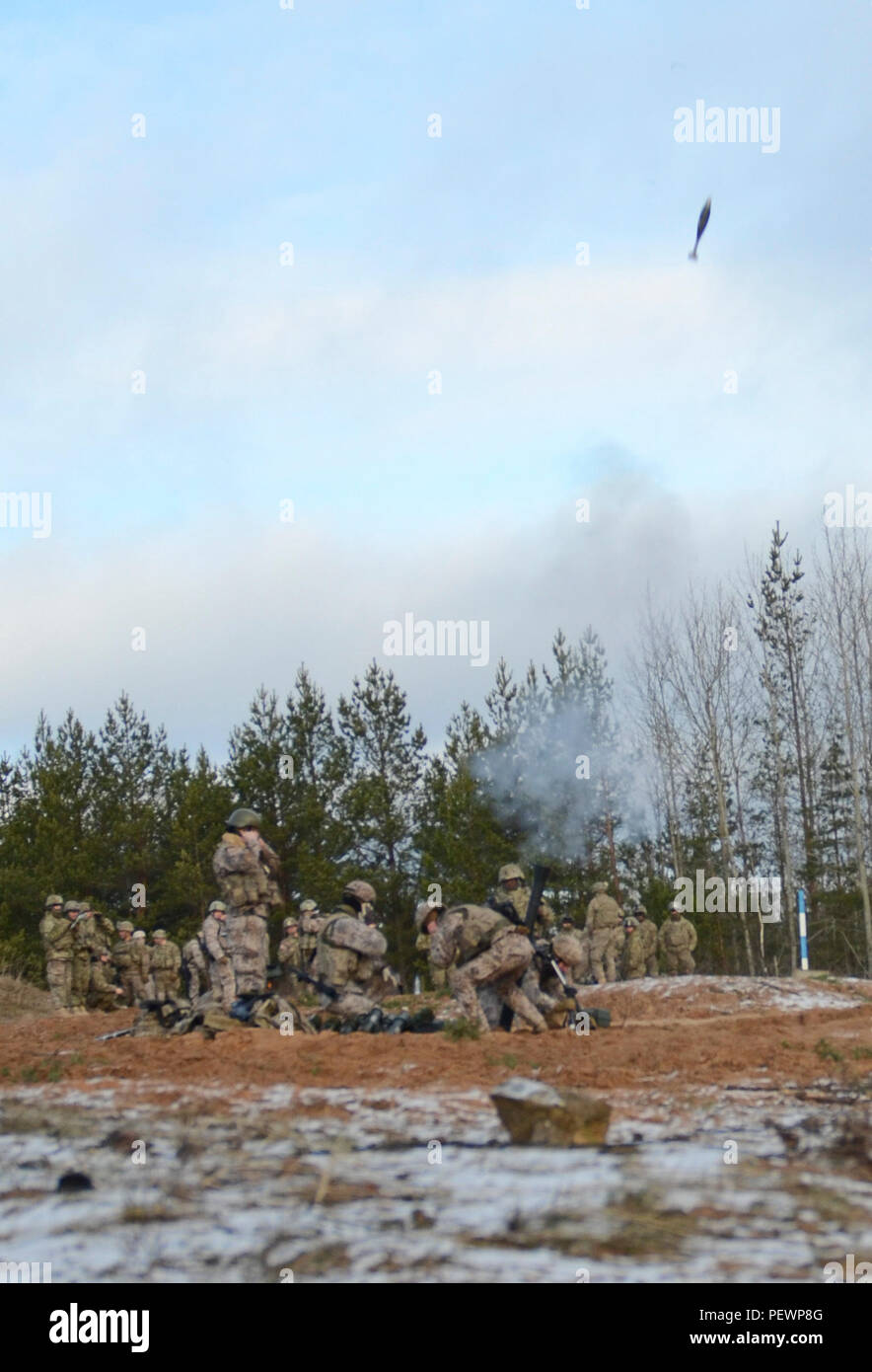 An 81 mm mortar round can be seen in midair as Soldiers of 3rd Squadron, 2nd Cavalry Regiment, stationed out of Vilseck, Germany, shoot it out of an M252 Mortar System during a joint training exercise in Adazi Training Area in Latvia, Feb. 4, 2016. (Photo by U.S. Army Staff Sgt. Steven M. Colvin/Released) - Stock Image