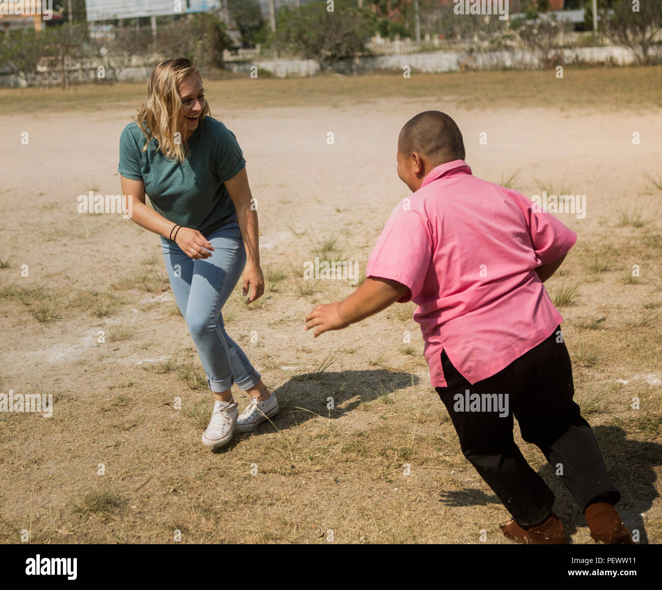 Lance Cpl  Macey D  Allcott plays tag with Aun Kubkhan at