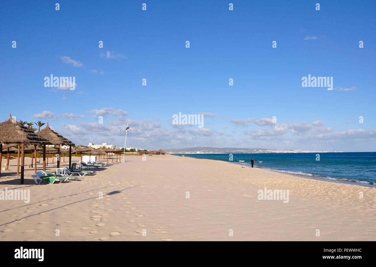 Tunesia: Empty beach in Hamameet-Yasmine. Only one fishermen is here. - Stock Image