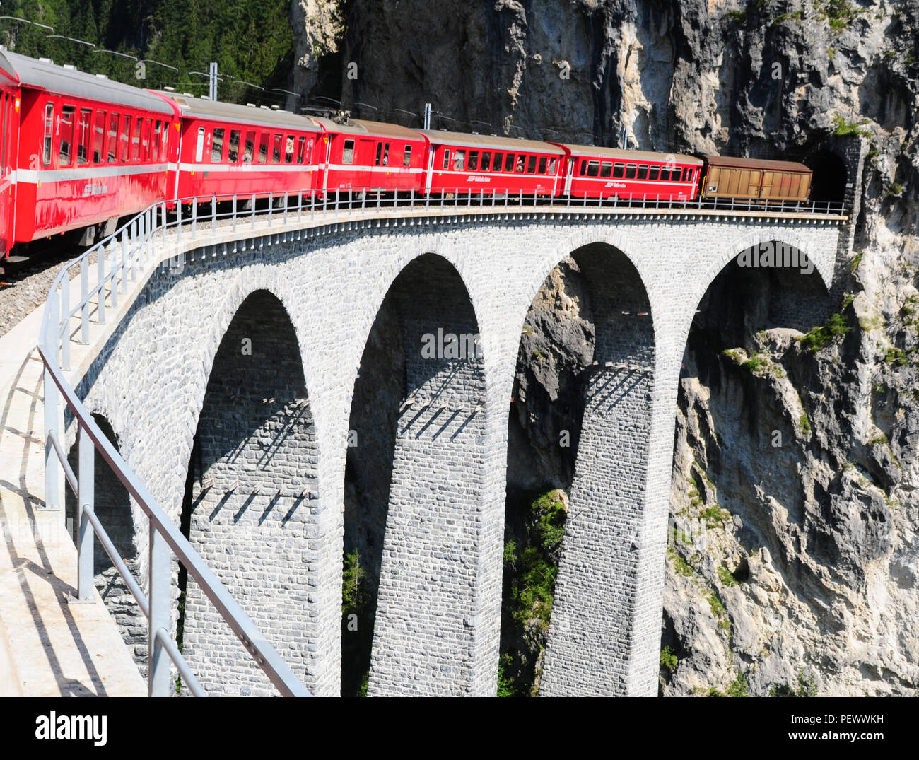 The Landwasser-Viaduct is part of the Unesco World Heritage Train Trip through the swiss alps in canton Graubünden - Stock Image